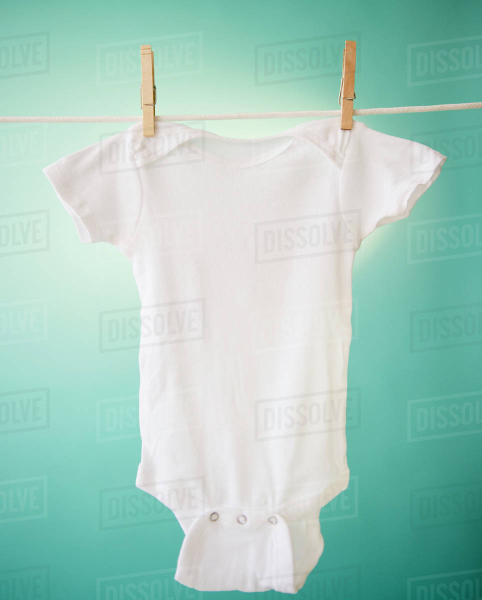 close up of baby clothes hanging on clothesline stock photo dissolve