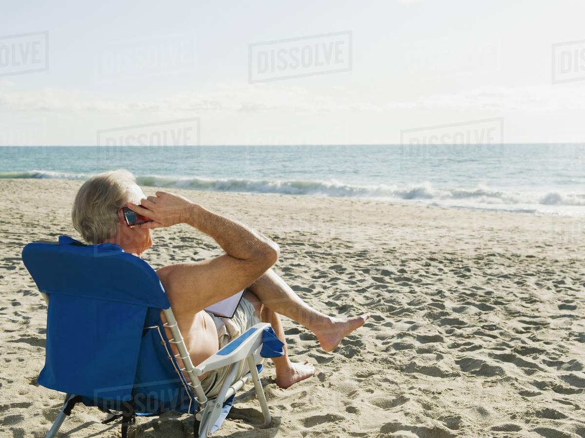 Man Relaxing In Beach Chair Stock Photo Dissolve