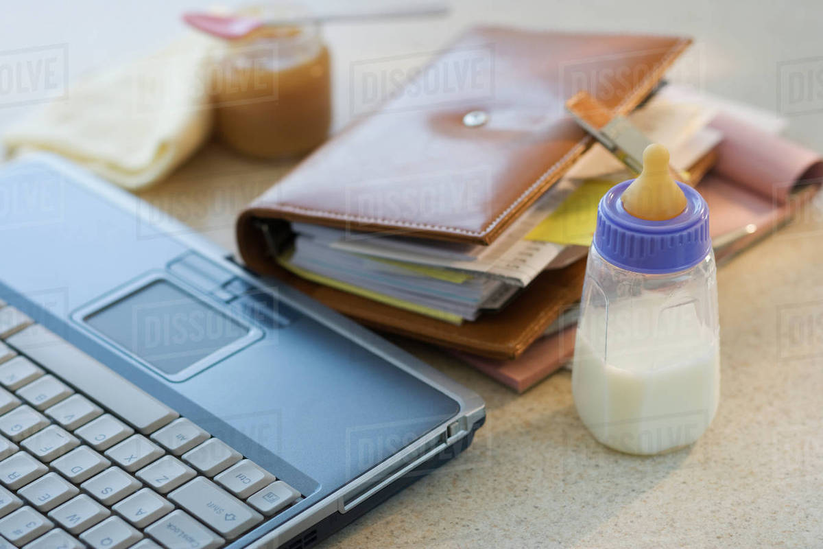 Wondrous Laptop Planner And Baby Bottle On Table Stock Photo Home Interior And Landscaping Spoatsignezvosmurscom