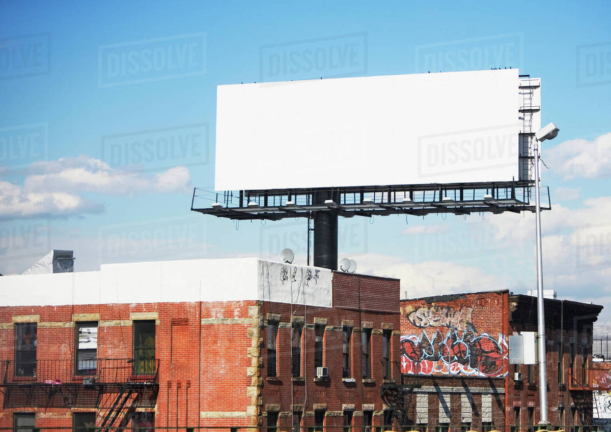 blank billboard over urban buildings stock photo dissolve