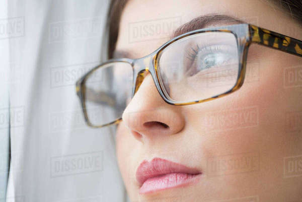 Close up of young woman with blue eyes wearing glasses Royalty-free stock photo