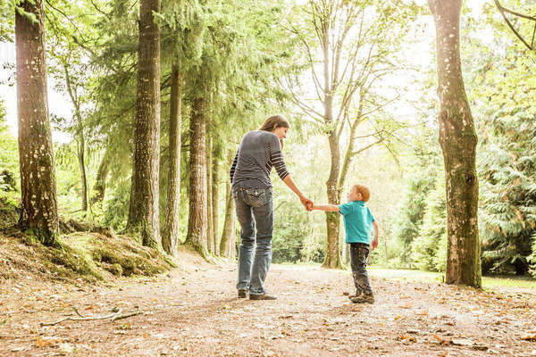 Mother walking with son (2-3) in park Royalty-free stock photo