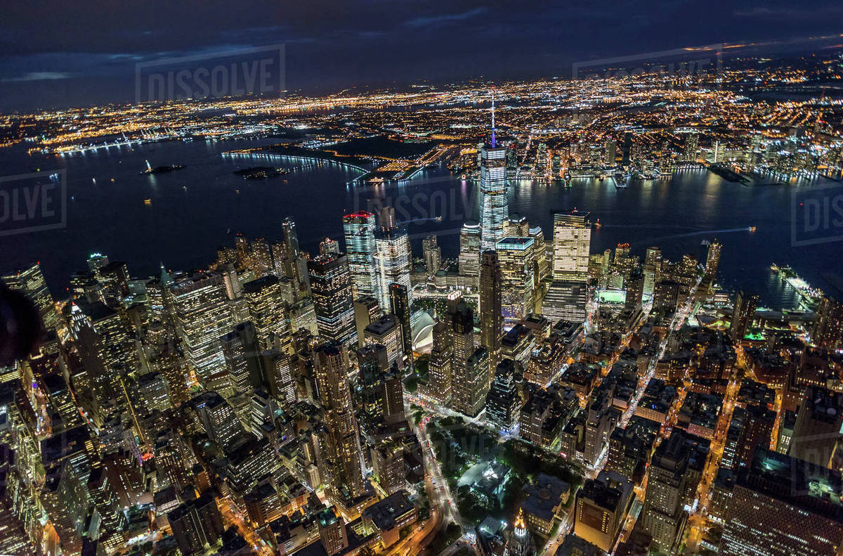 Usa New York New York City Manhattan Aerial View Of Illuminated Skyline With Harbor At Night Stock Photo Dissolve