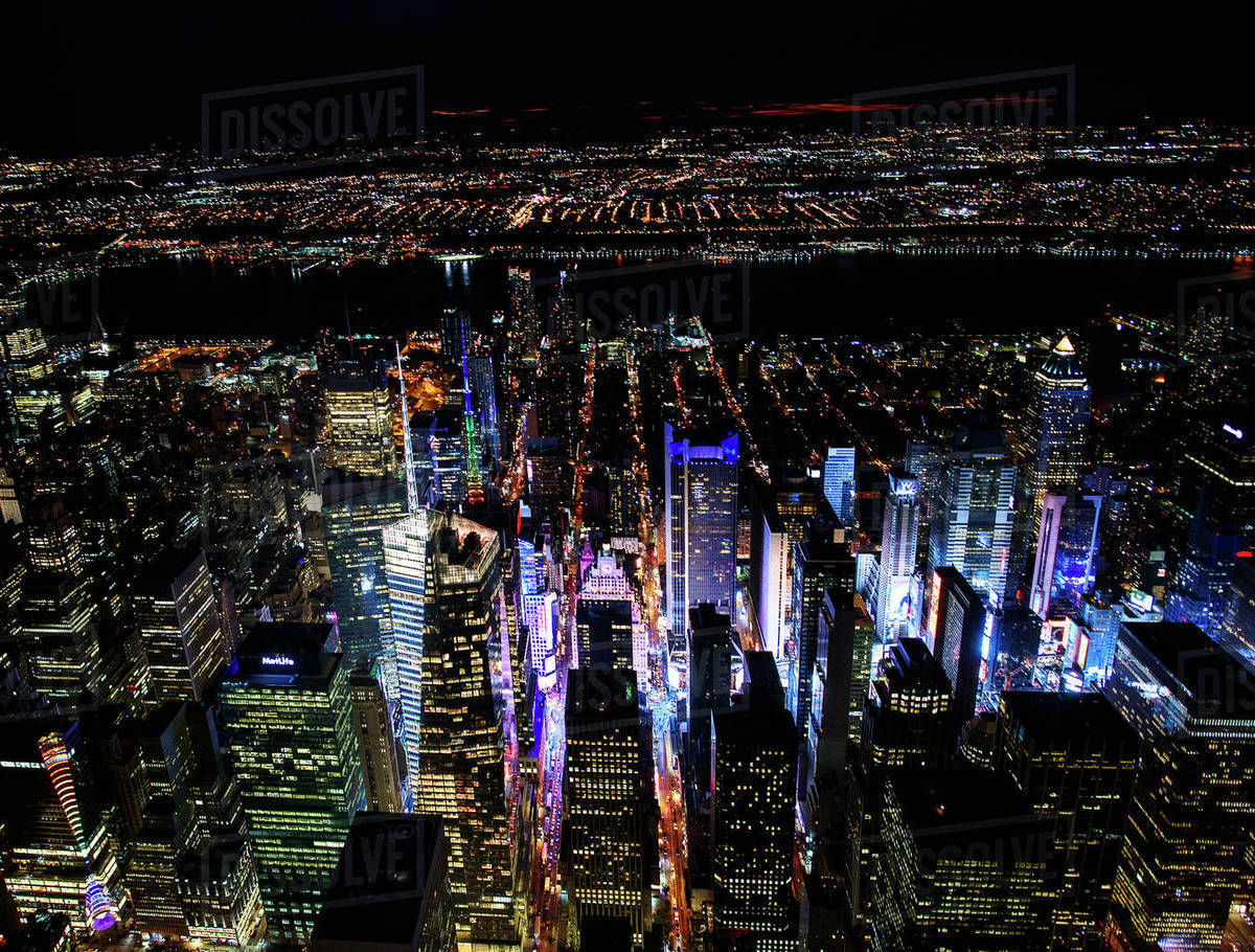 Usa New York New York City Manhattan Aerial View Of Illuminated Skyline With Times Square At Night Stock Photo Dissolve
