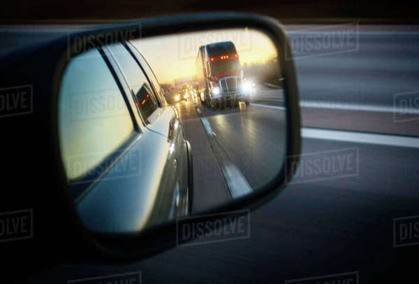 Truck on road reflecting in rear view mirror Royalty-free stock photo