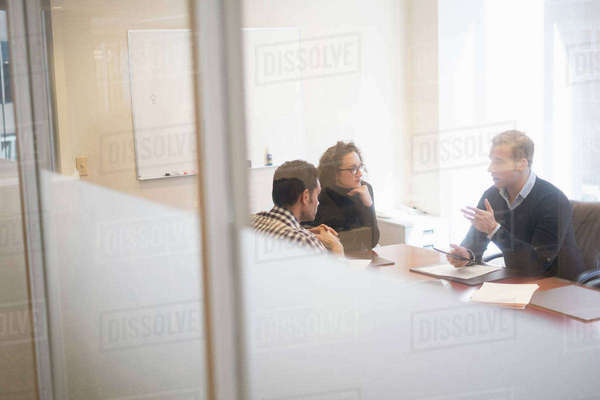 Young business people having meeting in board room Royalty-free stock photo