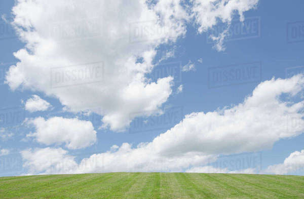 Cumulus clouds over hill Royalty-free stock photo