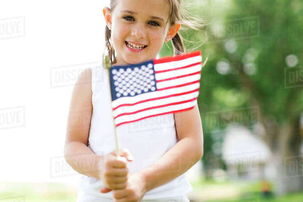 Girl (4-5) holding american flag Royalty-free stock photo
