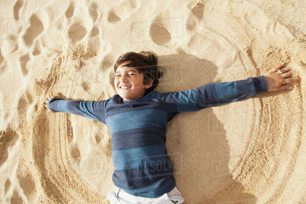 Boy (10-11) playing on beach Royalty-free stock photo