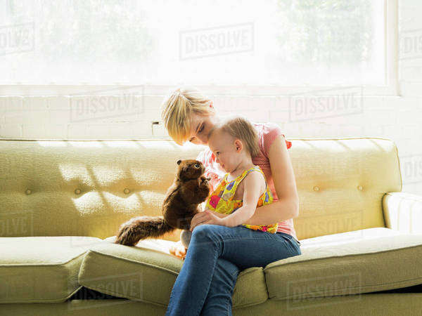 Mother playing with baby daughter (12-17 months) Royalty-free stock photo
