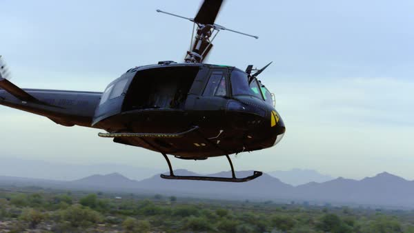 Huey helicopter banks left. Royalty-free stock video