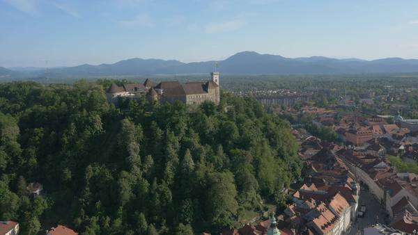 Aerial - Distancing from Castle Hill above the city of Ljubljana Royalty-free stock video