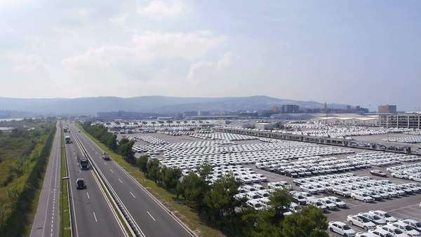 Aerial - Highway next to the shipping port full of cars ready to transport Royalty-free stock video