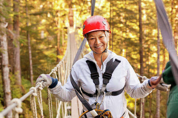 Portrait of woman on zip line course Royalty-free stock photo