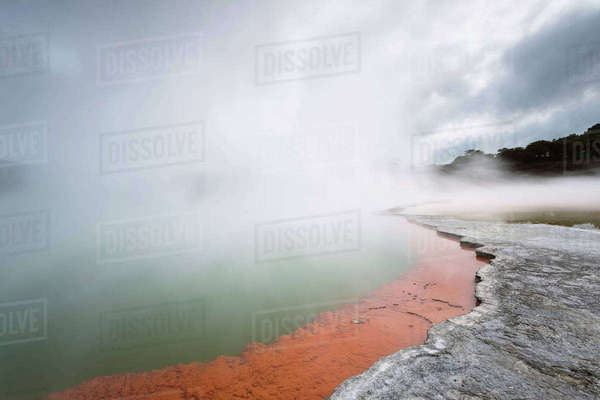 Smoke emitting through Pohutu geyser at Whakarewarewa Thermal Park Royalty-free stock photo