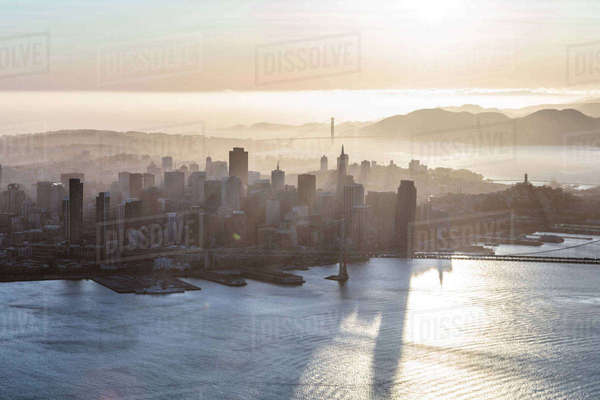 High angle view of Oakland Bay Bridge over sea in city at sunrise Royalty-free stock photo