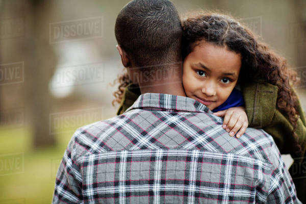 Father carrying his daughter (6-7) Royalty-free stock photo