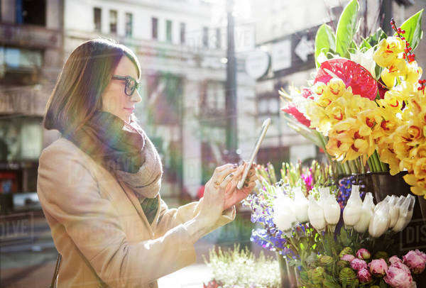 Woman taking photo of flowers Royalty-free stock photo