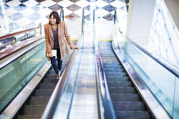 Elevated view of woman on escalator Royalty-free stock photo