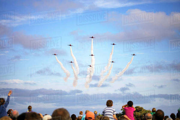 Crowd watching airplanes in air show Royalty-free stock photo