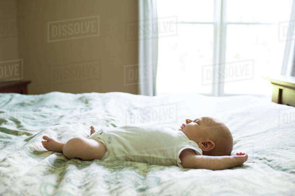 Baby boy sleeping on bed at home Royalty-free stock photo