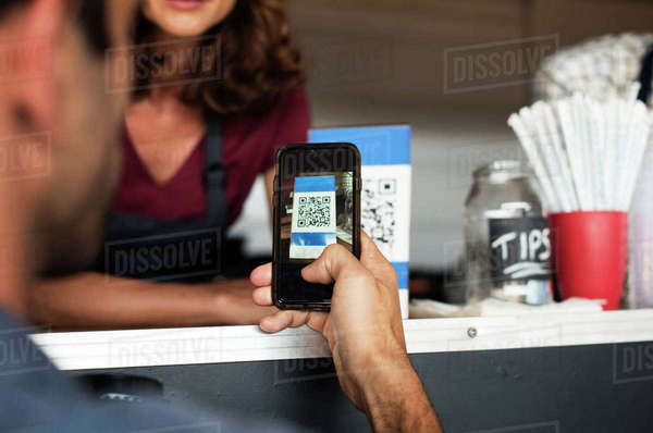 Cropped image of customer paying through smart phone at food truck Royalty-free stock photo