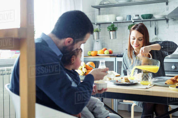 Family having breakfast at table in kitchen Royalty-free stock photo