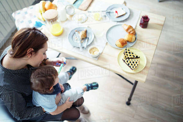 High angle view of mother feeding breakfast to son at table Royalty-free stock photo