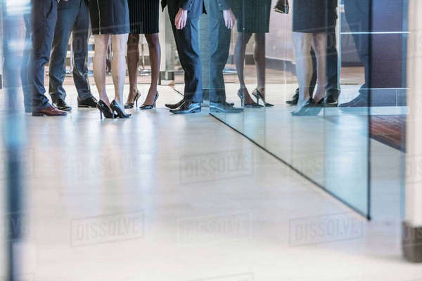 Low section of business people standing in office corridor Royalty-free stock photo