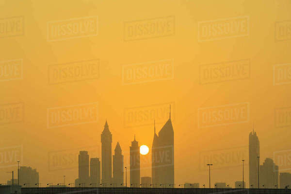 Silhouette skyscrapers against sky during sunset in city Royalty-free stock photo