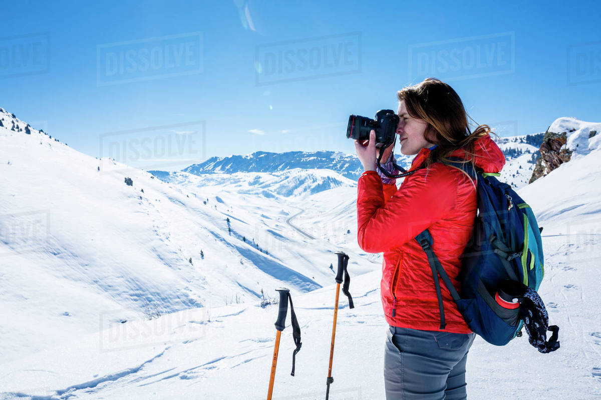 Hiker Photographing While Standing On Snow Covered Mountain At Joshua D1061 137 377