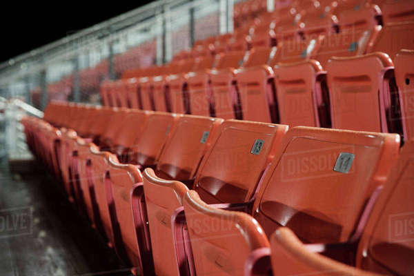 Empty seats in American football stadium at night Royalty-free stock photo