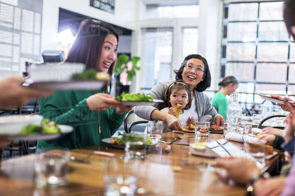 Happy family having lunch in restaurant Royalty-free stock photo