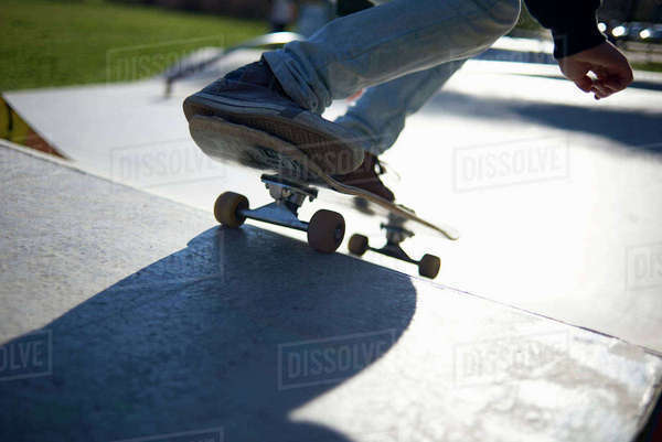 Low section of girl skateboarding on sports ramp at park Royalty-free stock photo