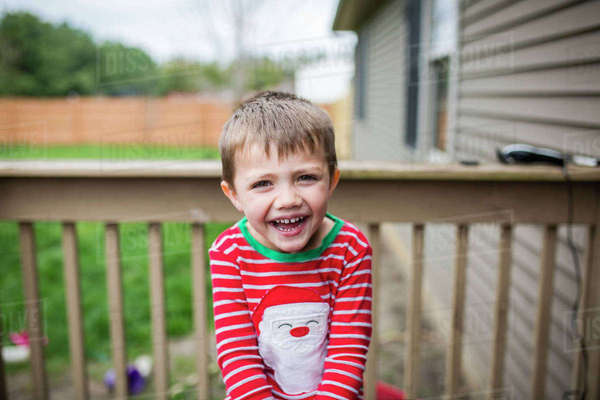 Portrait of happy boy standing in balcony Royalty-free stock photo