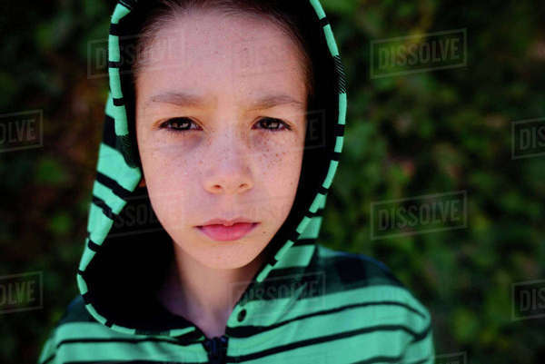 Portrait of confident boy in hood at park Royalty-free stock photo