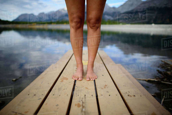 Low section of female hiker standing on pier at Banff National Park Royalty-free stock photo