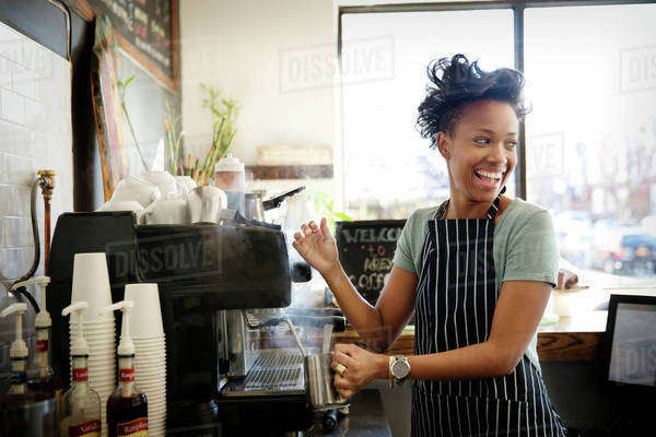 Smiling barista making coffee Royalty-free stock photo