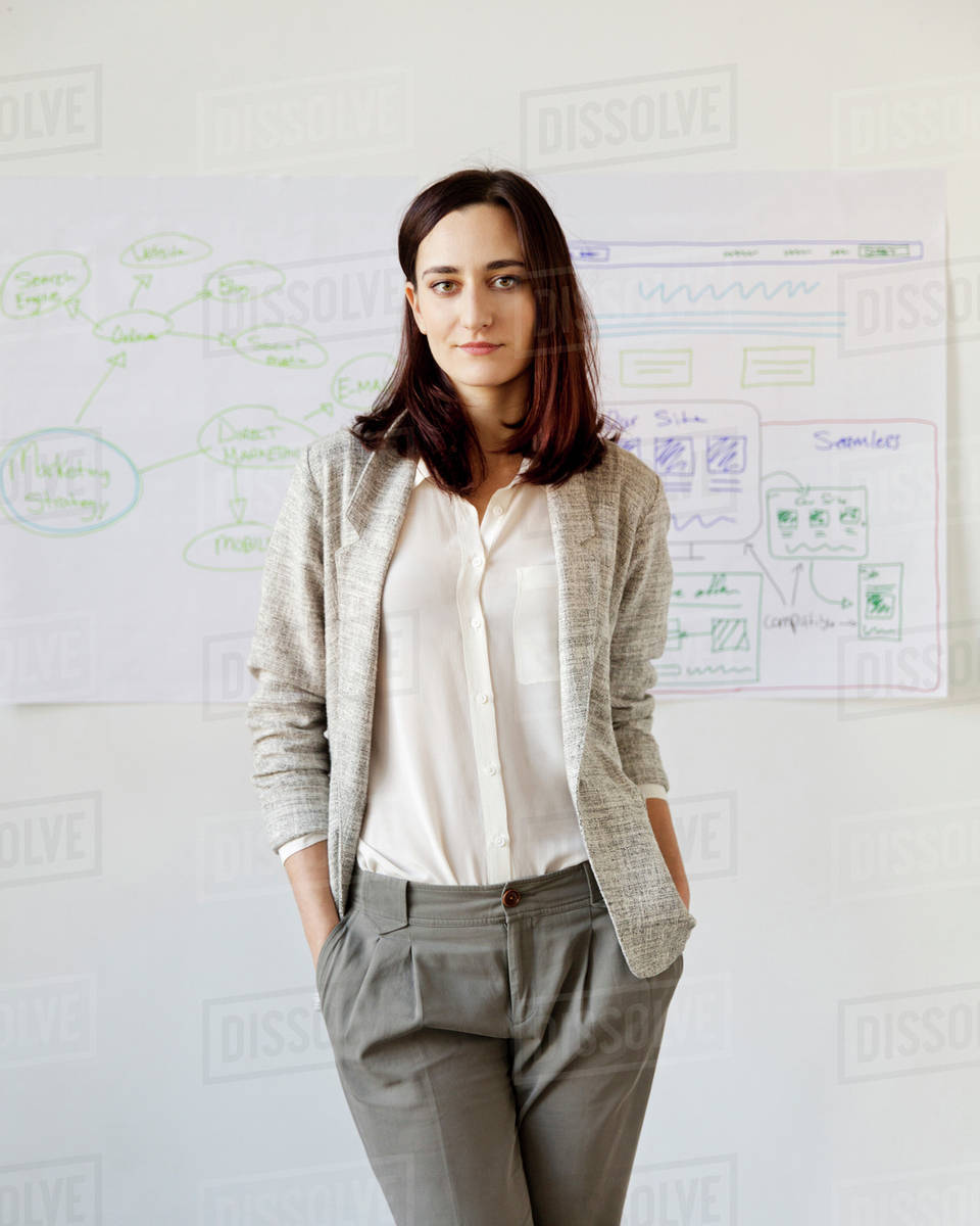 Portrait of confident businesswoman with hands in pocket standing at office Royalty-free stock photo