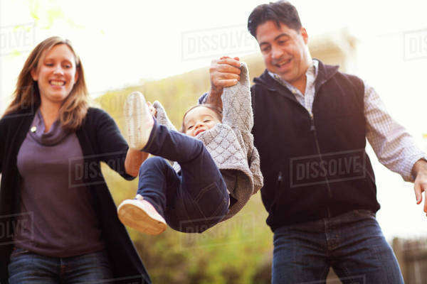 Low angle view of happy family playing on field Royalty-free stock photo