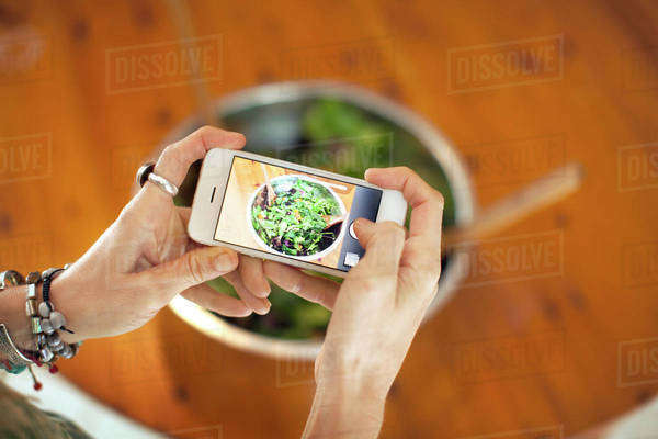 Woman taking photo of food, Royalty-free stock photo