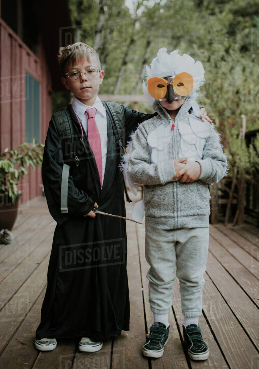 Full length portrait of brothers dressed up in costumes during Halloween Royalty-free stock photo
