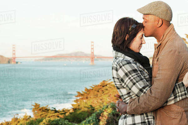 Couple embracing in front of Golden Gate Bridge Royalty-free stock photo