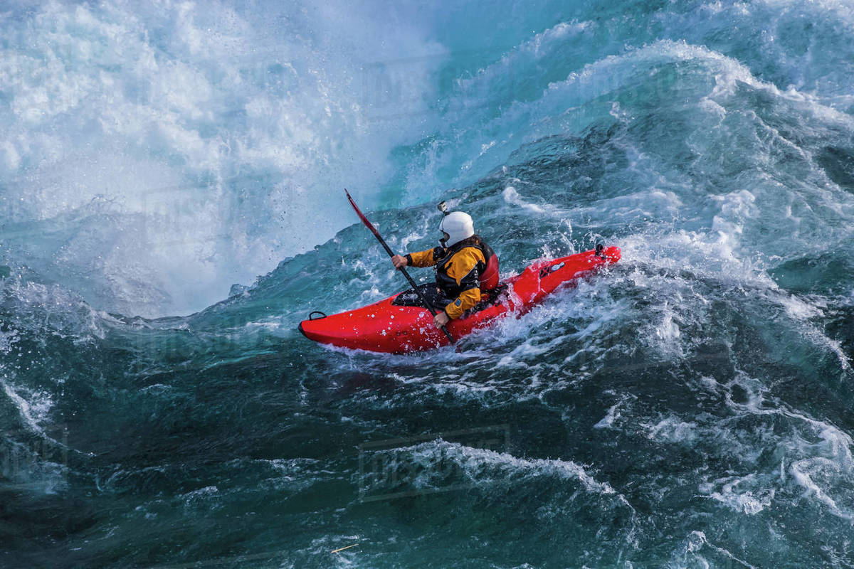Kayaker descending the Futaleufu River, a class 5 river in Patagonia Royalty-free stock photo