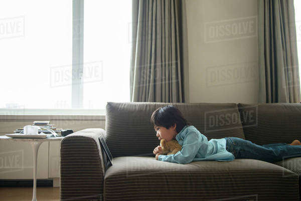 Boy watching movie on tablet pc Royalty-free stock photo