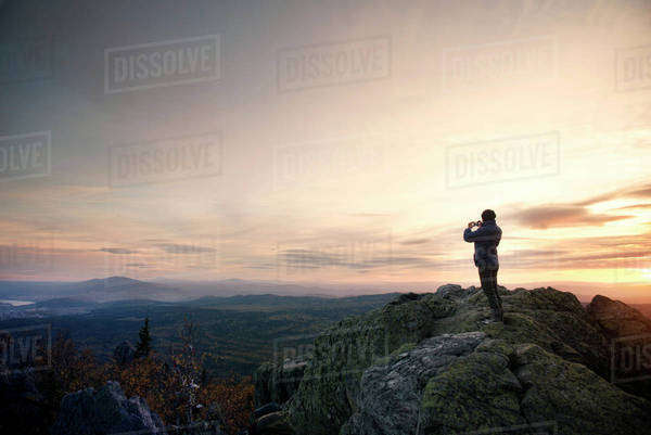 Woman standing on mountain during sunset Royalty-free stock photo