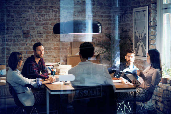 Five people sitting in office during meeting Royalty-free stock photo