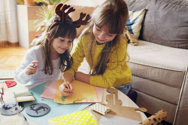 Two girls writing letter to Santa Royalty-free stock photo