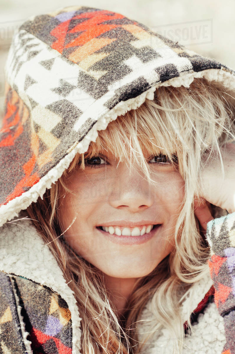 Close-up portrait of smiling woman wearing hooded jacket outdoors Royalty-free stock photo