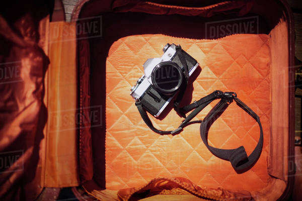 Overhead view of camera in orange suitcase Royalty-free stock photo